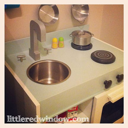IKEA Hack Play Kitchen  | littleredwindow.com  |  Make an adorable play kitchen with sink, stove, oven, fridge and microwave all from a set of old nighstands!