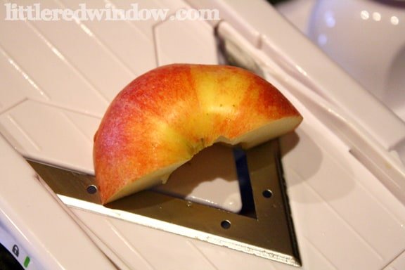 Slicing Apples on a mandolin on little Red Window