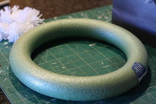 DIY Fluffy Snowflake Pom Pom Wreath, make a soft fluffy and easy snowflake wreath from pom poms! via littleredwindow.com