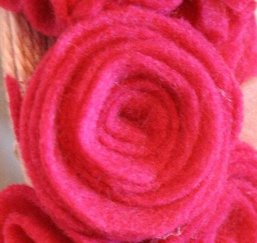 Valentine's Hearts and Flowers Felt Wreath    littleredwindow.com   Make a beautiful, fluffy Hearts and Flowers Wreath for Valentine's Day from Felt with this great tutorial!
