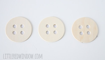 Sewing Room Giant Button Garland     littleredwindow.com     Make a sweet hand-painted giant button garland for your sewing or craft room with this great tutorial!