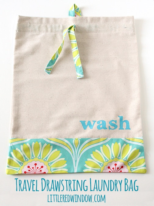Travel Drawstring Laundry Bag Tutorial  |  littleredwindow.com | Make a pretty and useful travel laundry bag with cute stenciled detail with this great tutorial!