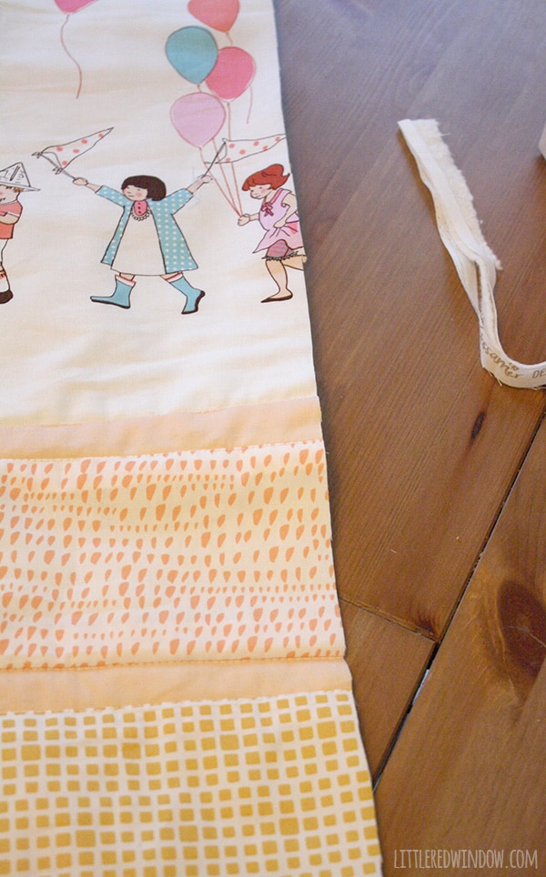 Simple Strip Crib Quilt  littleredwindow.com   This simple crib quilt is so much easier to make than it looks!
