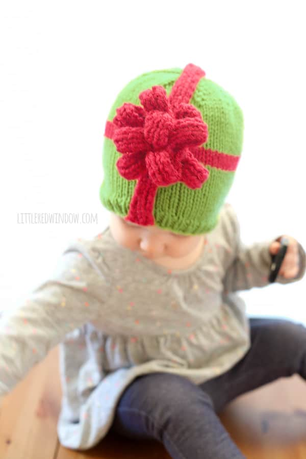 Wrap up your sweetest gift with this adorable Christmas Present Bow Hat Knitting Pattern! | littleredwindow.com