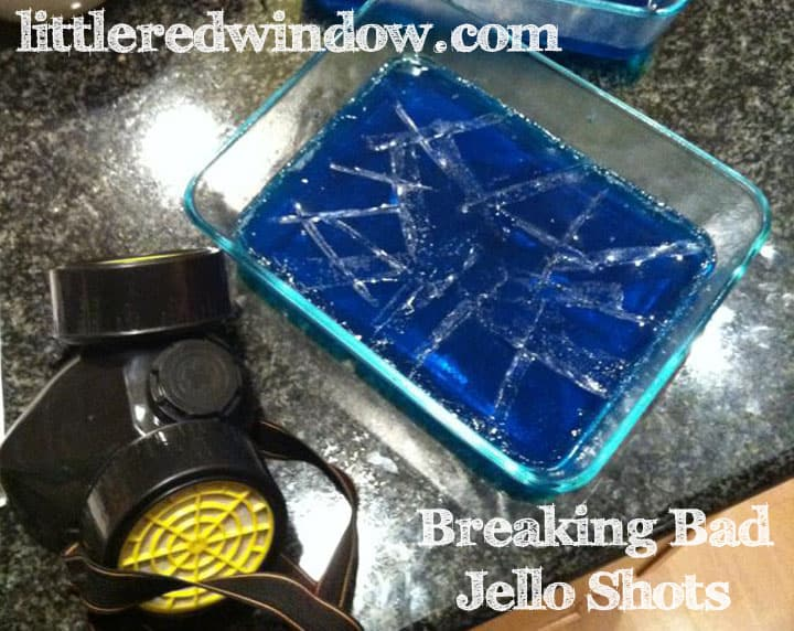 blue jello in a flat container next to a vented painting mask on the counter