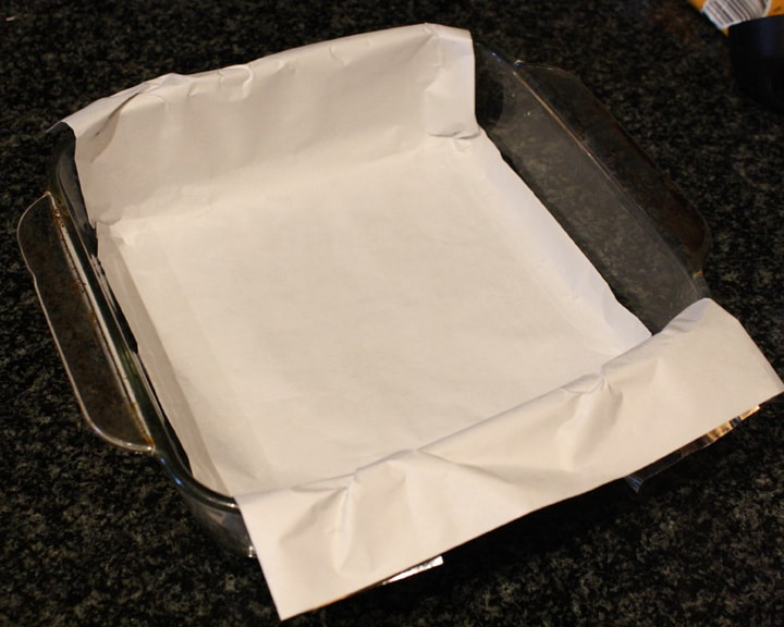 Lining a Baking Dish with Parchment for 7 Layer Magic Bars without Nuts!