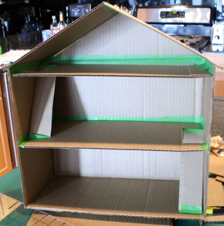 Finished basic house shape with two floors, slanted cardboard for the stairs and a roof