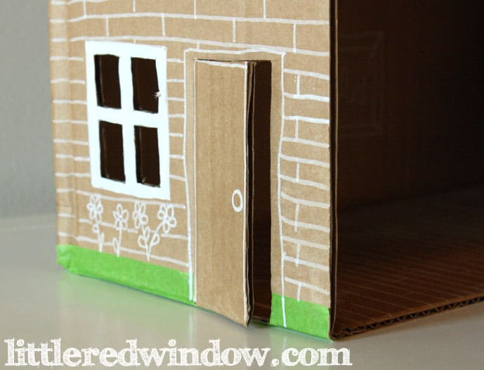Hand drawn front door, white lines on brown cardboard