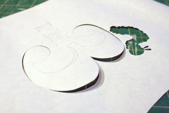Freezer Paper Stencil Cutting the Design on Little Red Window