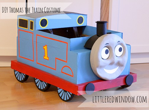 Finished cardboard box Thomas the train costume on the floor!