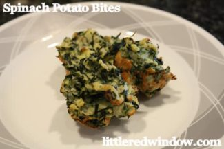3 spinach potato bites on a white plate with gray geometric pattern around the edge