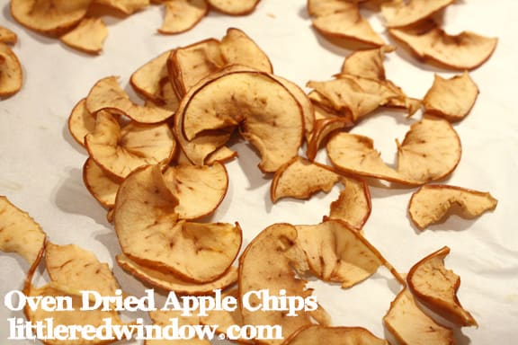 Oven dried apply chips on white parchment paper