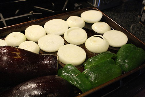 Roasting Eggplant, Green Pepper, and onions on Little Red Window