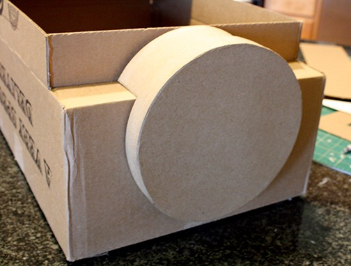 Round cardboard base attached to the front of the train shape