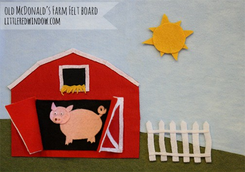 Closeup of felt barn with doors open and a pig inside!