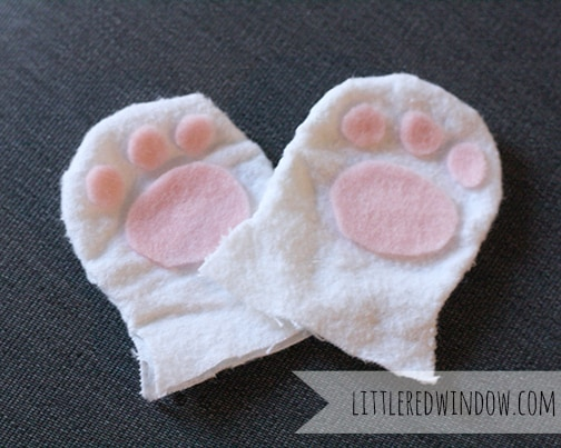 tiny baby mittens with pink paws made of felt
