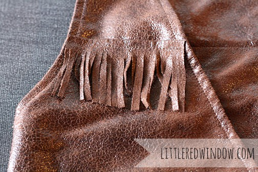 closeup of faux leather fringe vest