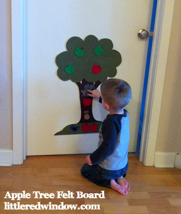 Toddler playing with Apple Tree Felt Board