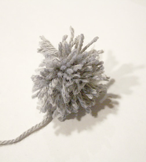 messy gray yarn pom pom