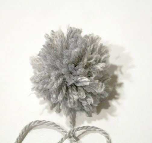neatly trimmed gray pom pom