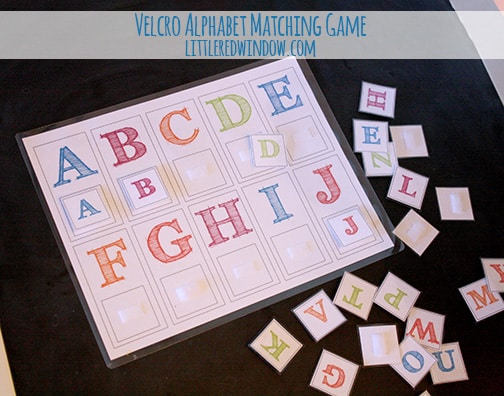 Laminated page showing letters A through J of the alphabet matching game with a pile of letter tiles next  to it