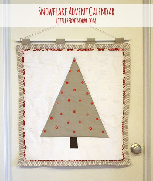 Quilted tan tree shape on a white background with red trim and red buttons