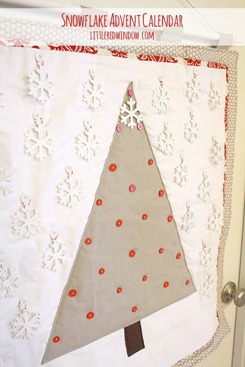 Quilted snowflake advent calendar with one snowflake on the top of the tree