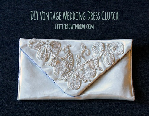DIY Vintage Wedding Dress Envelope Clutch in white satin with beaded trim on the flap, on a dark gray background