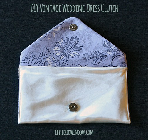DIY Vintage Wedding Dress Envelope Clutch with the flap open showing the periwinkle floral lining