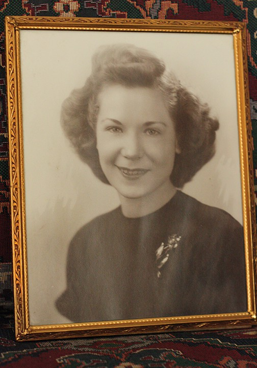 Vintage photo in a gold frame of a woman with short hair from the 1940's