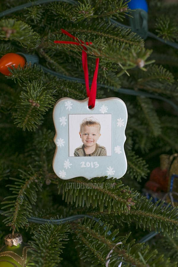 """finished ornament hanging on a Christmas tree, this side has little boy's picture and the date """"2013"""""""