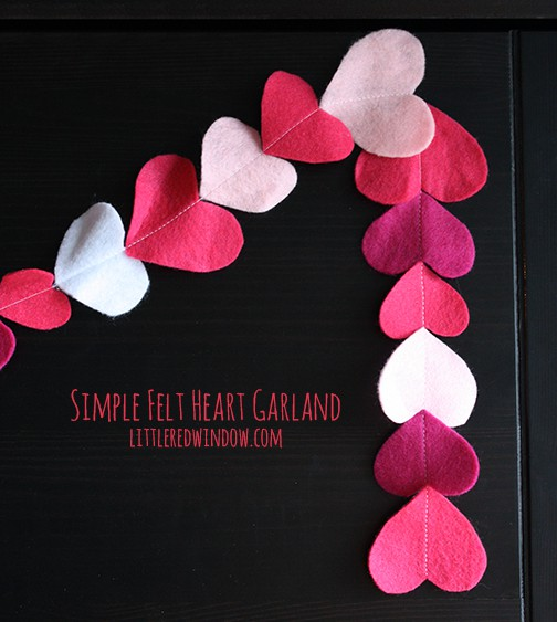 Closeup Pink and white heart garland on a black background