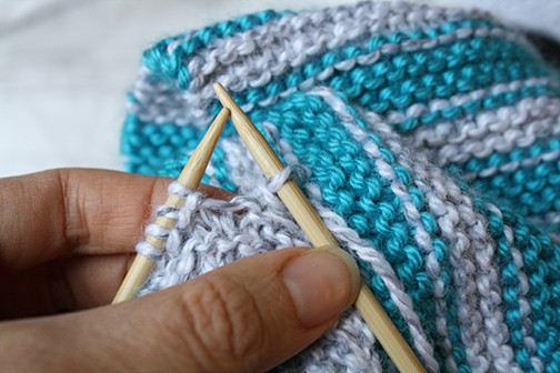 photo showing how to Bind off one stitch by lifting the original first stitch over the new second stitch that you just created and off the needle