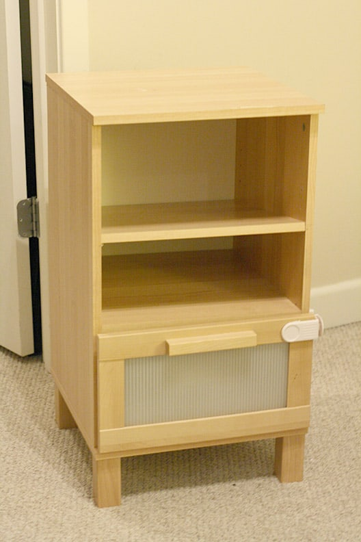 light wood IKEA nighstand with two shelves and drawer below