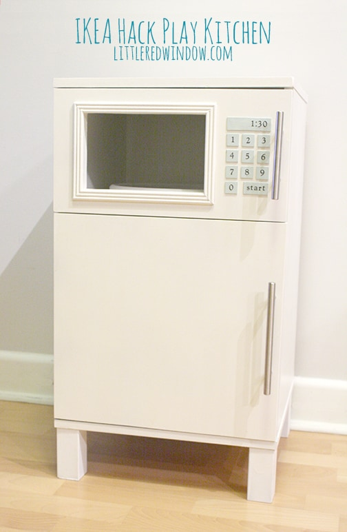 Closeup of play fridge/microwave with the doors closed