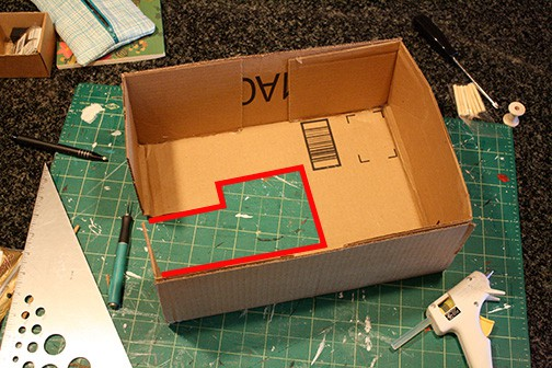 sewing machine shape with red line added to show where to add cardboard shapes for sides