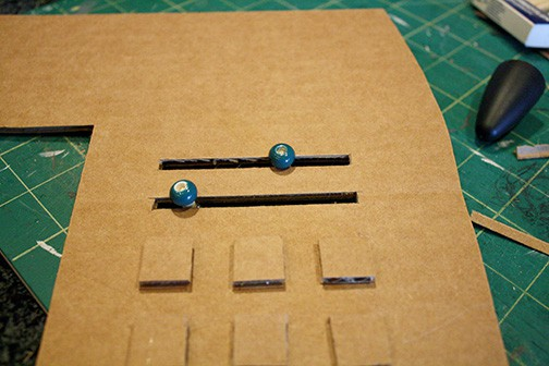 beads added to the dowels to make sliders on the slots