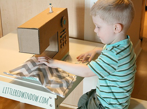 DIY Cardboard Box Play Sewing Machine | littleredwindow.com | Great tutorial for an adorable play sewing machine made out of an old box!