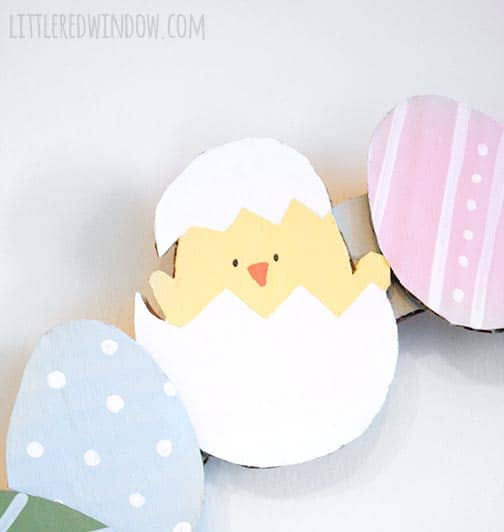 This cute little chick hatching from his egg is made from recycled cardboard!