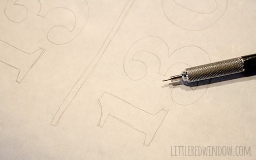 piece of paper with numbers drawn on it and the tip of a mechanical pencil