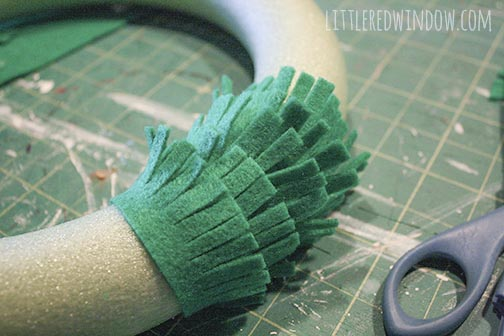 Make fluffy grass from felt for a St. Patrick's Day Shamrock Wreath!