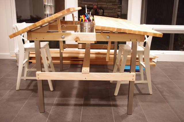 side view of a tilted top drawing table for kids