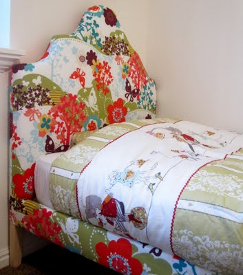 headboard wrapped in floral fabric