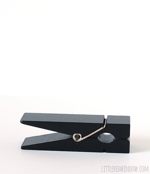 Large black clothespin on white background