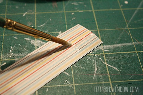 Paper strip glued on to the side of the giant clothespin