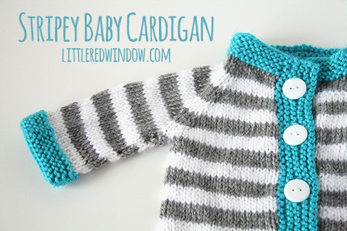 closeup of gray and white striped knit baby cardigan with blue trim