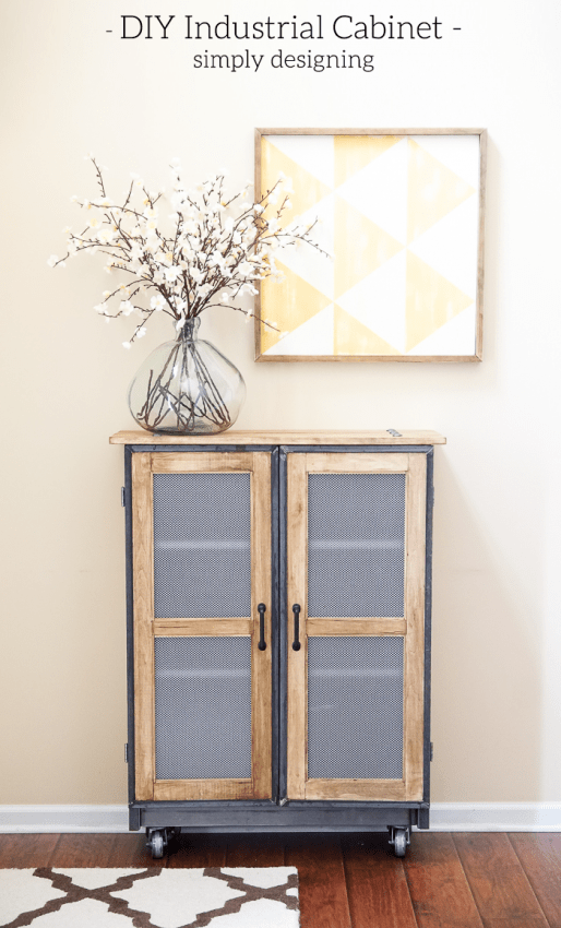 Industrial metal and wood storage cabinet with a vase on top