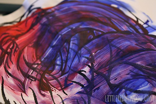 blue and red swirled kid's fingerpainting on white paper