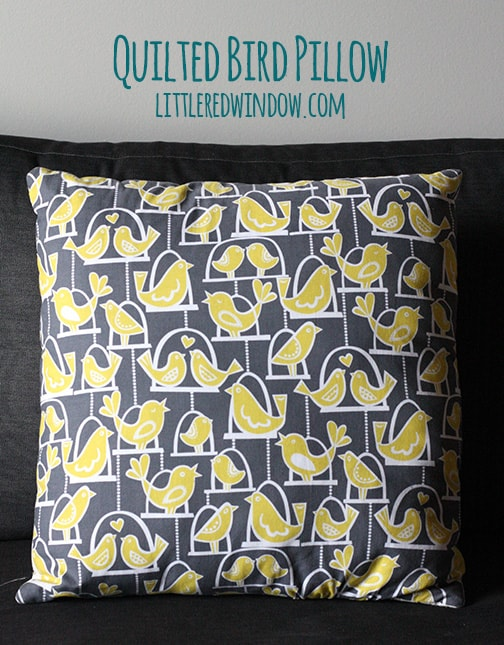Back side of Quilted bird pillow with bird patterned fabric on it
