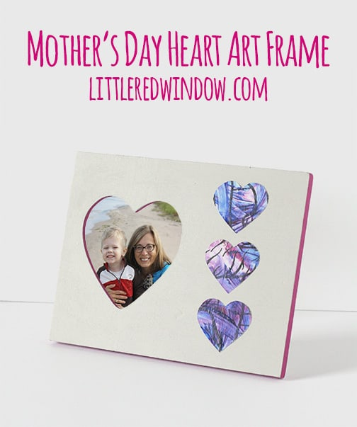 frame with heart shapes cut from child's artwork applied to the frame
